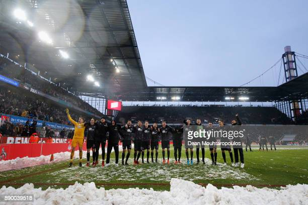 Players of SC Freiburg celebrate with the away supporters after victory in the Bundesliga match between 1 FC Koeln and SportClub Freiburg at...
