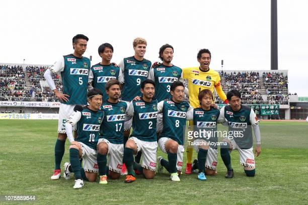 Players of SC Sagamihara lineup for team photograph prior to the JLeague J3 match between SC Sagamihara and Kagoshima United at Gion Stadium on...
