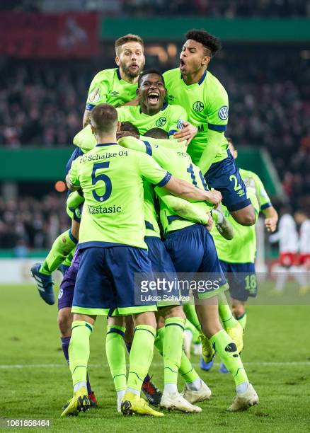 Players of Schalke 04 celebrate their win after the penalty shoot out the DFB Cup match between 1 FC Koeln and FC Schalke 04 at RheinEnergieStadion...