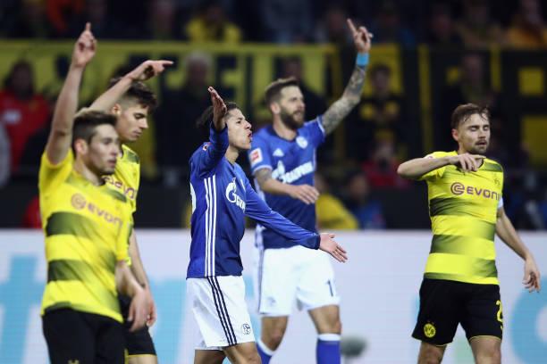 Players of Schalke and Dortmund gesture during the Bundesliga match between Borussia Dortmund and FC Schalke 04 at Signal Iduna Park on November 25,...