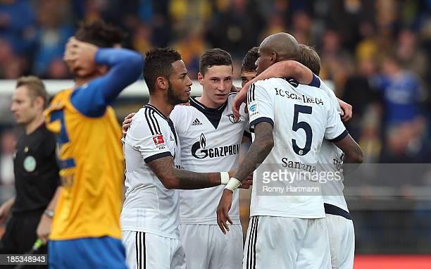 Players of Schalke celebrate after the Bundesliga match between Eintracht Braunschweig and FC Schalke 04 at Eintracht Stadion on October 19 2013 in...