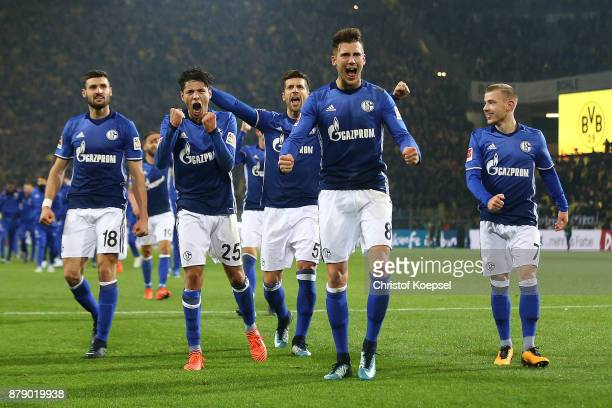 Players of Schalke celebrate after the Bundesliga match between Borussia Dortmund and FC Schalke 04 at Signal Iduna Park on November 25 2017 in...