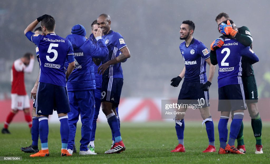 Players of Schalke celebrate after winning the Bundesliga match between 1. FSV Mainz 05 and FC Schalke 04 at Opel Arena on March 9, 2018 in Mainz, Germany.