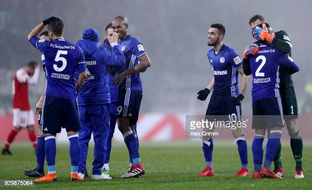 Players of Schalke celebrate after winning the Bundesliga match between 1 FSV Mainz 05 and FC Schalke 04 at Opel Arena on March 9 2018 in Mainz...