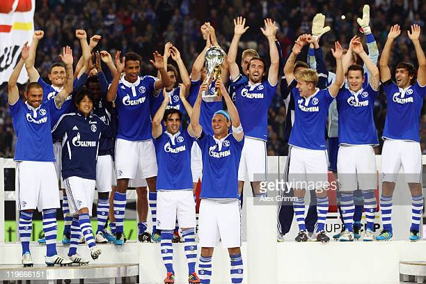 Players of Schalke celebrate after winning the Supercup match against Borussia Dortmund at Veltins Arena on July 23 2011 in Gelsenkirchen Germany