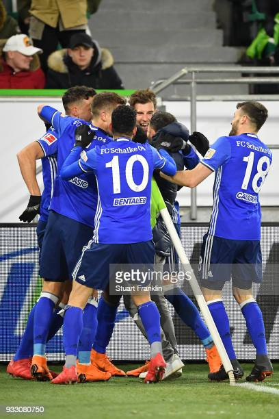 Players of Schalke celebrate an own goal by Robin Knoche of Wolfsburg to make it 01 during the Bundesliga match between VfL Wolfsburg and FC Schalke...