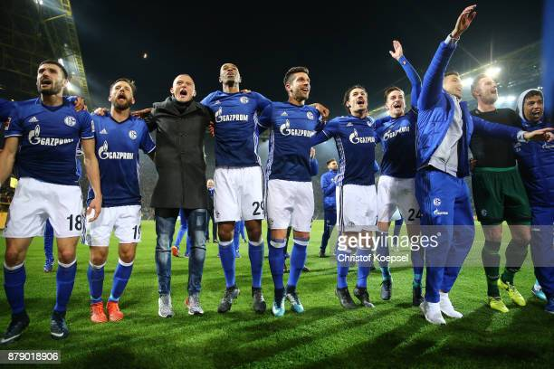 Players of Schalke celebrate in front of their supporters after the Bundesliga match between Borussia Dortmund and FC Schalke 04 at Signal Iduna Park...
