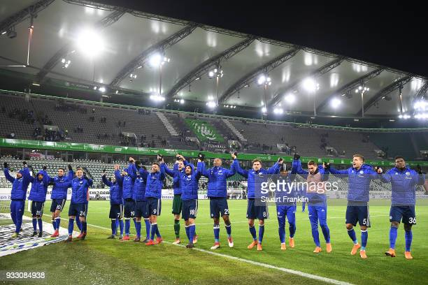Players of Schalke celebrate in front of their supports after the Bundesliga match between VfL Wolfsburg and FC Schalke 04 at Volkswagen Arena on...
