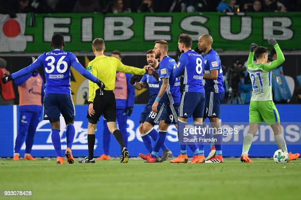 Players of Schalke protest after referee Benjamin Cortus awards Wolfsburg with a penalty during the Bundesliga match between VfL Wolfsburg and FC...