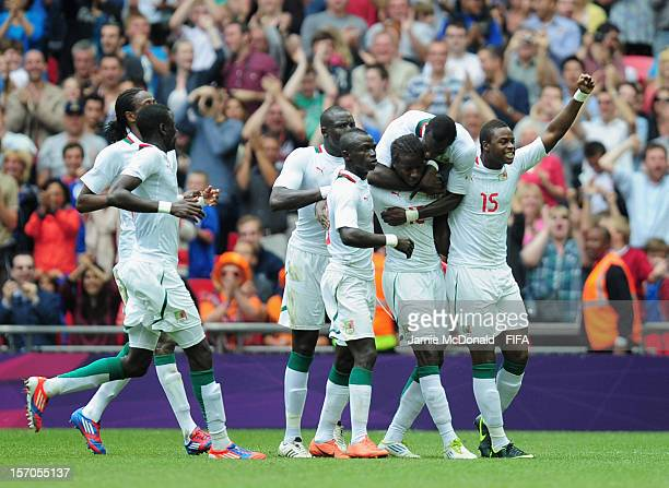 Players of Senagal celebrate the goal of Ibrahima Balde during the Men's Football Quarter Final match between Mexico and Senegal on Day 8 of the...