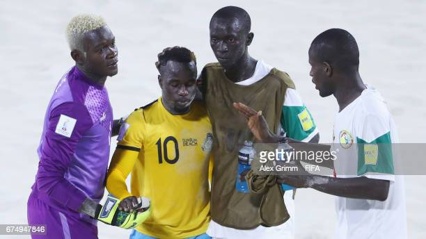 Players of Senegal comfort Lesly St Fleur of Bahamas after the FIFA Beach Soccer World Cup Bahamas 2017 group A match between Senegal and Bahamas at...
