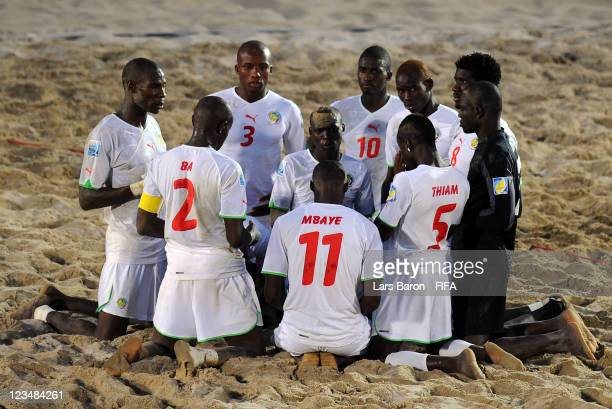 Players of Senegal say a prayer before the penalty shoot out during the FIFA Beach Soccer World Cup Group A match between Senegal and Italy at...