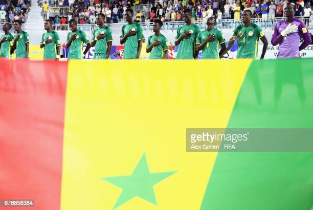 Players of Senegal sing their national anthem prior to the FIFA Beach Soccer World Cup Bahamas 2017 quarter final match between Italy and Senegal at...