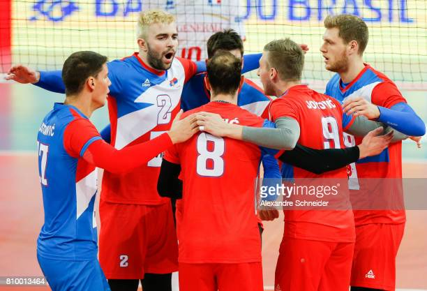 Players of Serbia celebrate a point during the match between Serbia and France at Arena da Baixada Stadium during day three of the FIVB World League...