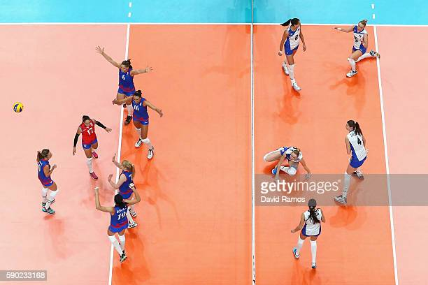 Players of Serbia celebrate after winning a point during the Women's Quarterfinal match between Japan and The United States on day 11 of the Rio 2106...
