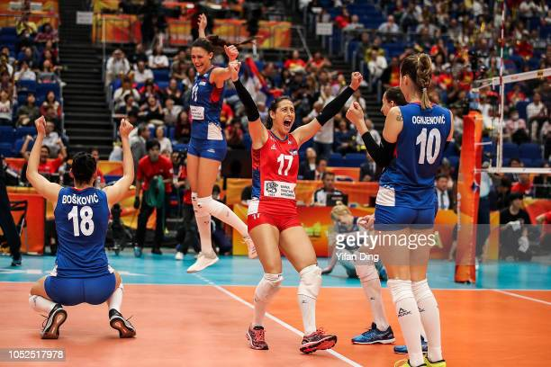 Players of Serbia celebrate after winning match point during the FIVB Women's World Championship semi final between Serbia and Netherlands at...