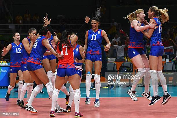 Players of Serbia celebrate defeating Russia during the Women's Quarterfinal match between Serbia and Russia on day 11 of the Rio 2106 Olympic Games...