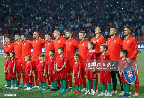 Players of Serbia sing national anthem prior to the UEFA Euro 2020 qualifier between Serbia and Portugal at Stadium Crvena Zvezda on September 7,...