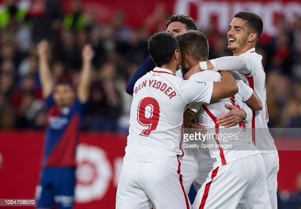Players of Sevilla celebrates scoring the team's opening goal during the La Liga match between Sevilla FC and SD Huesca at Estadio Ramon Sanchez...