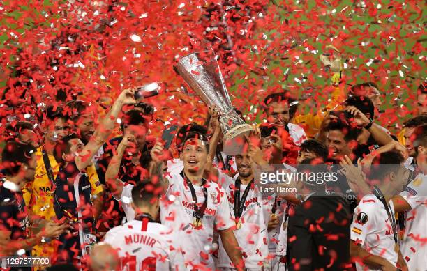 Players of Sevilla FC celebrate with the UEFA Europa League Trophy following victory in the UEFA Europa League Final between Seville and FC...