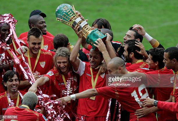 Players of Sevilla FC hold a trophy aloft as they celebrate their victory of the Russian Railways Cup pre season friendly match against FC Lokomotiv...
