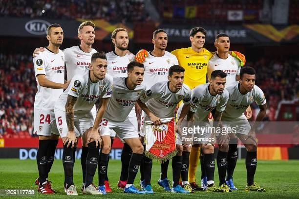Players of Sevilla FC pose for a team photo prior the UEFA Europa League round of 32 second leg match between Sevilla FC and CFR Cluj at Estadio...