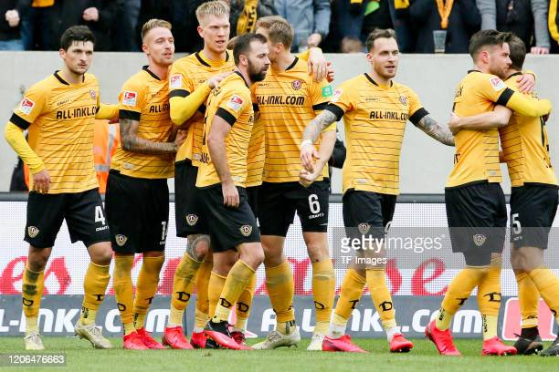 Players of SG Dynamo Dresden celebrate during the Second Bundesliga match between SG Dynamo Dresden and FC Erzgebirge Aue on March 08 2020 in Dresden...