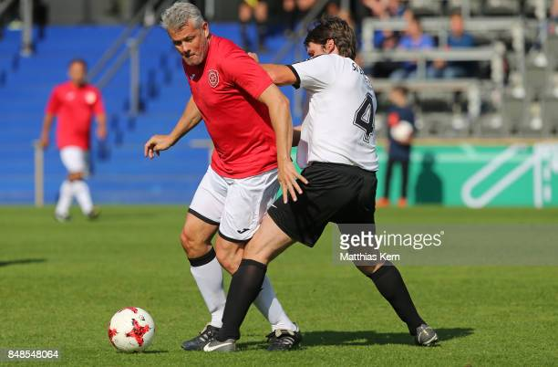Players of SG Hoechst Classique and SV Bad Kleinen battle for the ball during the DFB over 40 and 50 cup at Amateurstadion on September 17 2017 in...