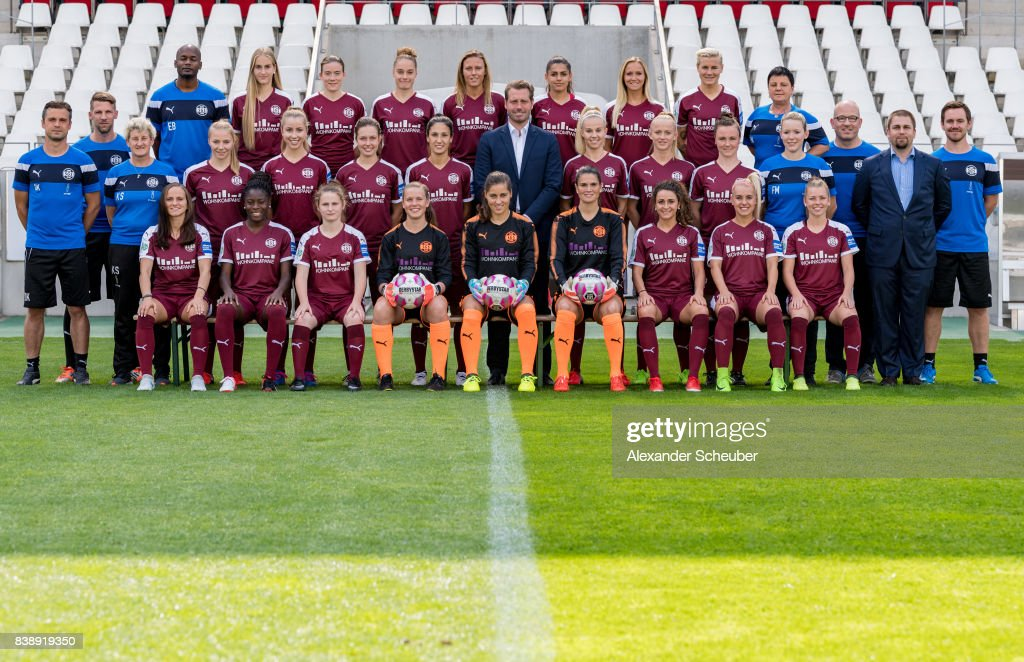 Players of SGS Essen pose with Allianz Insurance Manager Bjoern Bartnick (M) for a group photo during the Allianz Frauen Bundesliga Club Tour at Stadion Essen on August 22, 2017 in Essen, Germany.