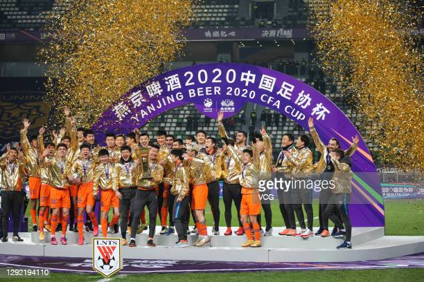 Players of Shandong Luneng Taishan celebrate with the champions trophy after winning the 2020 Chinese Football Association Cup final match between...