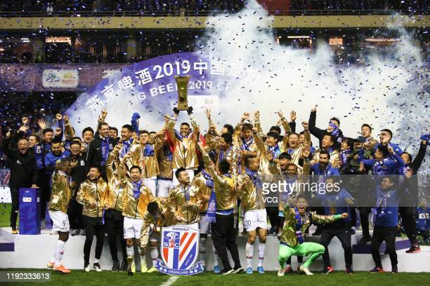 Players of Shanghai Greenland Shenhua celebrate with champion trophy after winning 2019 Chinese Football Association Cup final match between Shanghai...
