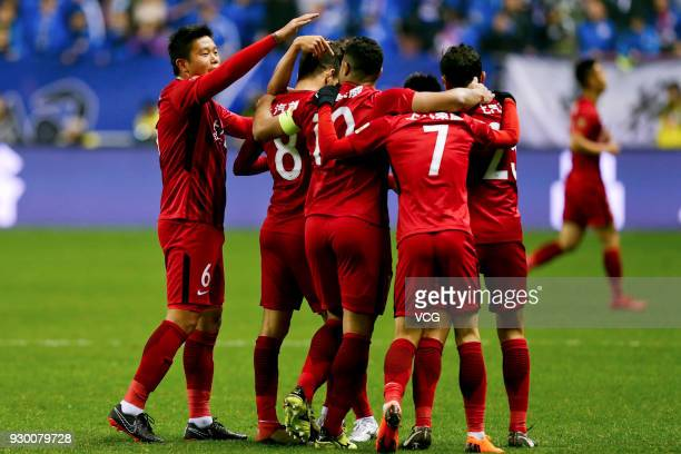 Players of Shanghai SIPG celebrate a point during the 2018 Chinese Football Association Super League second round match between Shanghai Greenland...