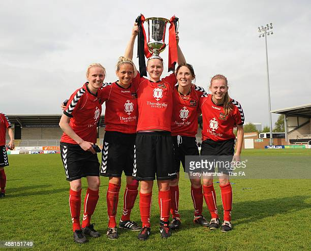 Players of Sheffield FC Ladies celebrate with the trophy after winning the FA Women's Premier League Cup Final between Cardiff City Ladies and...