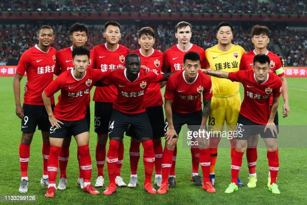 Players of Shenzhen FC pose for a photo before the first round match of 2019 Chinese Football Association Super League between Shenzhen FC and Hebei...