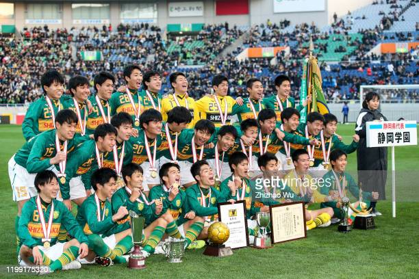 Players of Shizuoka Gakuen attend the award ceremony and celebrate the champion with trophy after the 98th All Japan High School Soccer Tournament...