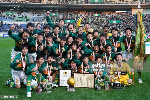 Players of Shizuoka Gakuen celebrate the victory with the flag and trophies after the 98th All Japan High School Soccer Tournament final match...