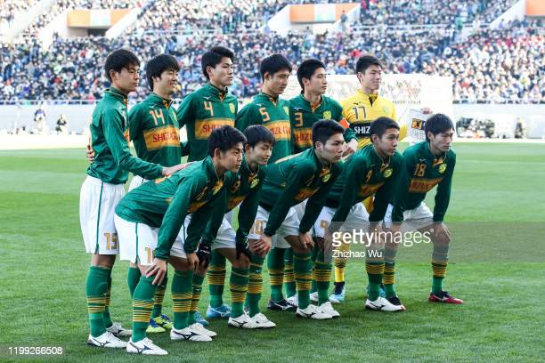 Players of Shizuoka Gakuen line up for team photos prior to the 98th All Japan High School Soccer Tournament final match between Aomori Yamada and...