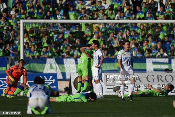 Players of Shonan Bellmare celebrate while players of Tokushima Vortis show their frustrations following a draw during the J.League J1/J2 Play-Off...