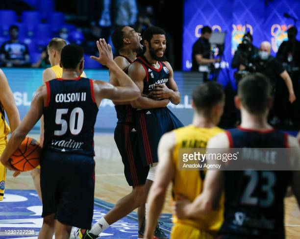 Players of SIG Strasbourg celebrate after reaching the semi-final at the end of the FIBA Champions League quarter final basketball match between...