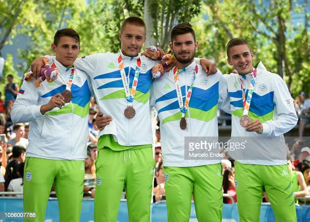 Players of Slovenia pose with their their Bronze medals after the Men's Bronze Medal Game against Ukraine during day 11 of he Buenos Aires Youth...