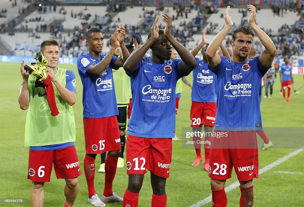Players of SM Caen thank their supporters following the French Ligue 1 match between Olympique de Marseille (OM) and SM Caen at Stade Velodrome on August 8, 2015 in Marseille, France.