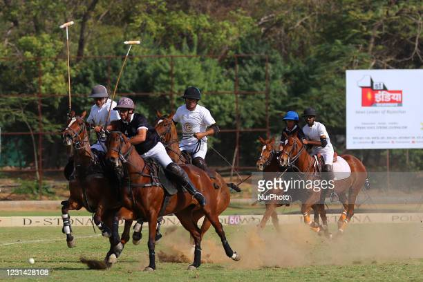 Players of Sona Polo and Golden Globe teams in action during the semi final polo match of 'Rajmata Gayatri Devi Memorial Cup' at Polo ground in...