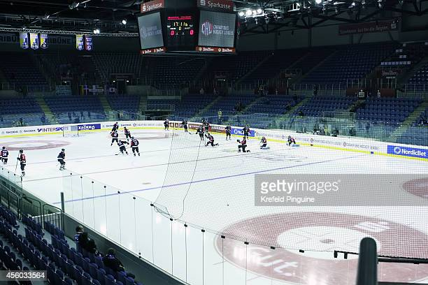 Players of Sonderjyske Vojens come out late for the warmup during the Champions Hockey League group stage game between Krefeld Pinguine and...
