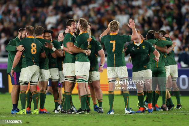 Players of South Africa celebrate victory against England following the Rugby World Cup 2019 Final between England and South Africa at International...