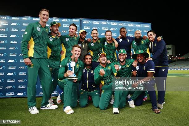 Players of South Africa celebrate with the ODI series trophy after winning game five of the One Day International series between New Zealand and...