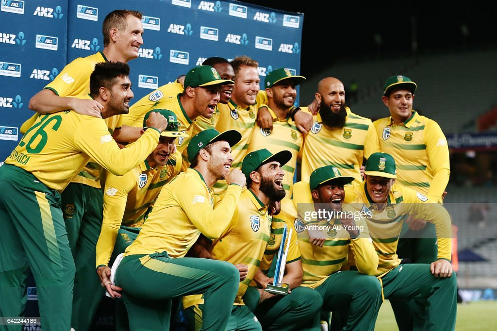 Players of South Africa celebrate with the T20 trophy after winning the first International Twenty20 match between New Zealand and South Africa at Eden Park on February 17, 2017 in Auckland, New Zealand.