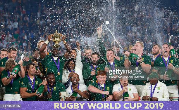 Players of South Africa celebrates with the trophy after winning the Rugby World Cup 2019 Final between England and South Africa at International...