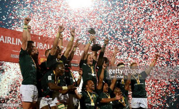 Players of South Africa pose for photos with the trophy after winning the Cup Final match between South Africa and New Zealand on Day Three of the...