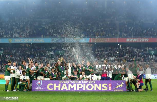 Players of South Africa spray beer as Siya Kolisi of South Africa lifts the Web Ellis cup following their victory against England in the Rugby World...