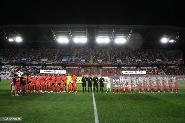 Players of South Korea and Chile line up prior to the International friendly match between South Korea and Chile at Busan Asiad Main Stadium on...
